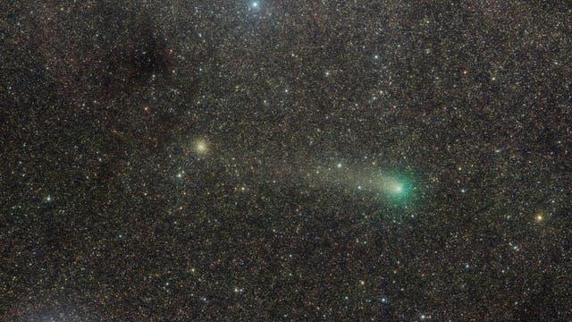 Comet PanSTARRS above the Milky Way