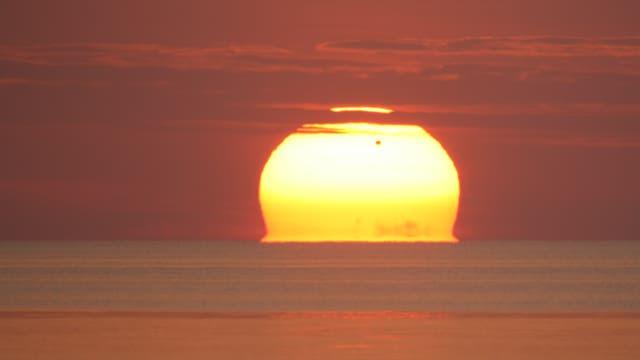 Venustransit bei Sonnenaufgang über der Ostsee
