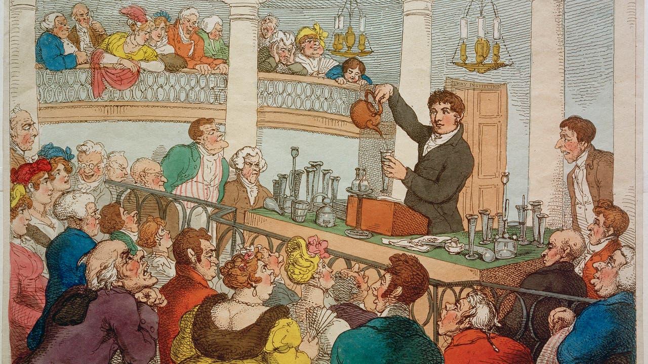 Friedrich Accum bei einer Chemie-Darbietung im Surrey Institute in London. Karikatur von Thomas Rowlandson, um 1810.