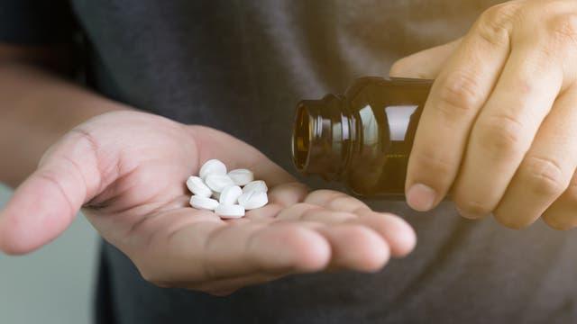 Pillen in der Hand