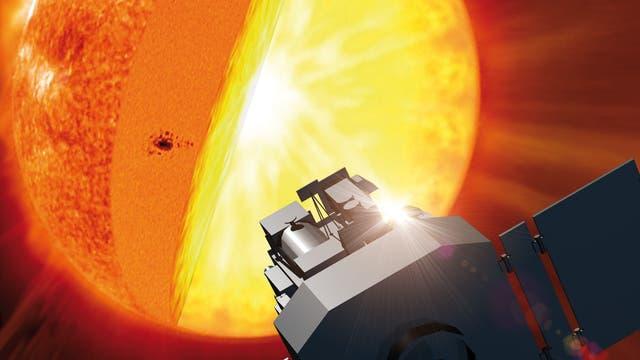 Der Sonnensatellit SOHO vor der Sonne (künstlerische Darstellung)