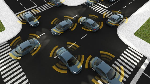 Autonome Autos der Zukunft kommen heil über die Kreuzung, weil sie mit ihren Sensoren über den perfekten Rundumblick verfügen.