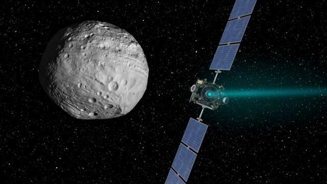 Künstlerische Darstellung der NASA-Raumsonde Dawn vor dem Asteroiden Vesta