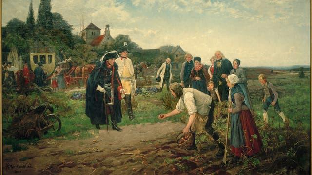 Friedrich II. von Preußen besucht Bauern, um die Kartoffelernte zu inspizieren.