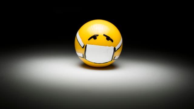 Emoji mit bedecktem Mund