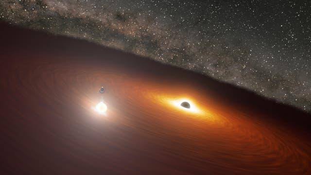 Illustration der beiden massereichen Schwarzen Löcher in der Galaxie OJ 287