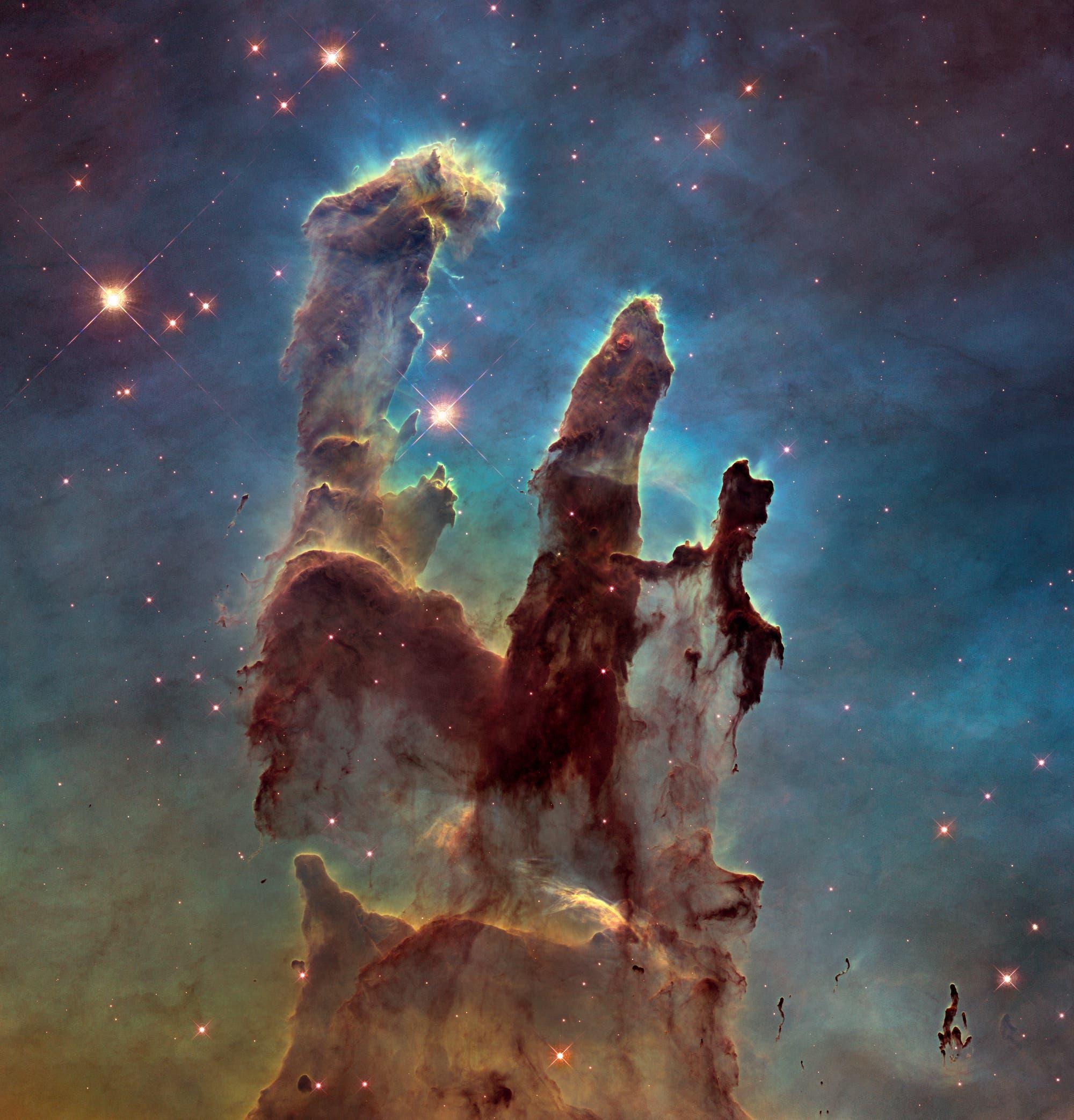 """Die """"Säulen der Schöpfung"""" im Adlernebel (Aufnahme des Weltraumteleskops Hubble)"""