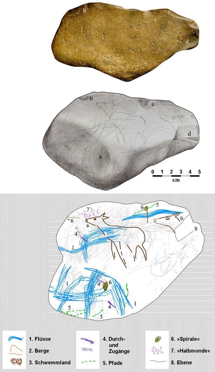 Faustgroßer Brocken aus der Höhle von Abauntz im Baskenland, mit Landkarte übermalt