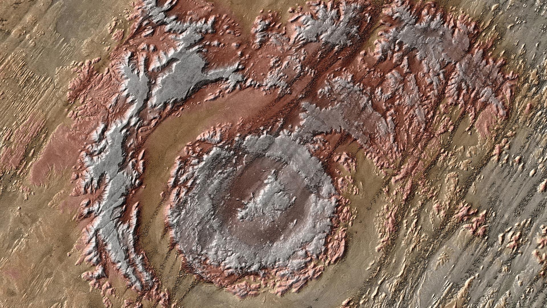 Die Aorounga-Struktur im nordafrikanischen Tschad entspricht auf den ersten Blick nur teilweise dem typischen Bild eines Einschlagkraters, denn die Spuren des kosmischen Treffers verwitterten im Laufe der Zeit beträchtlich.