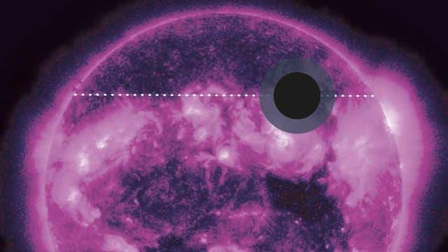 Der heiße Jupiter HD 189733 Ab während des Transits vor seinem Zentralgestirn