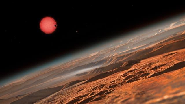 Künstlerische Darstellung des sehr kühlen Zwergsterns TRAPPIST-1 aus der Nähe eines seiner Planeten.