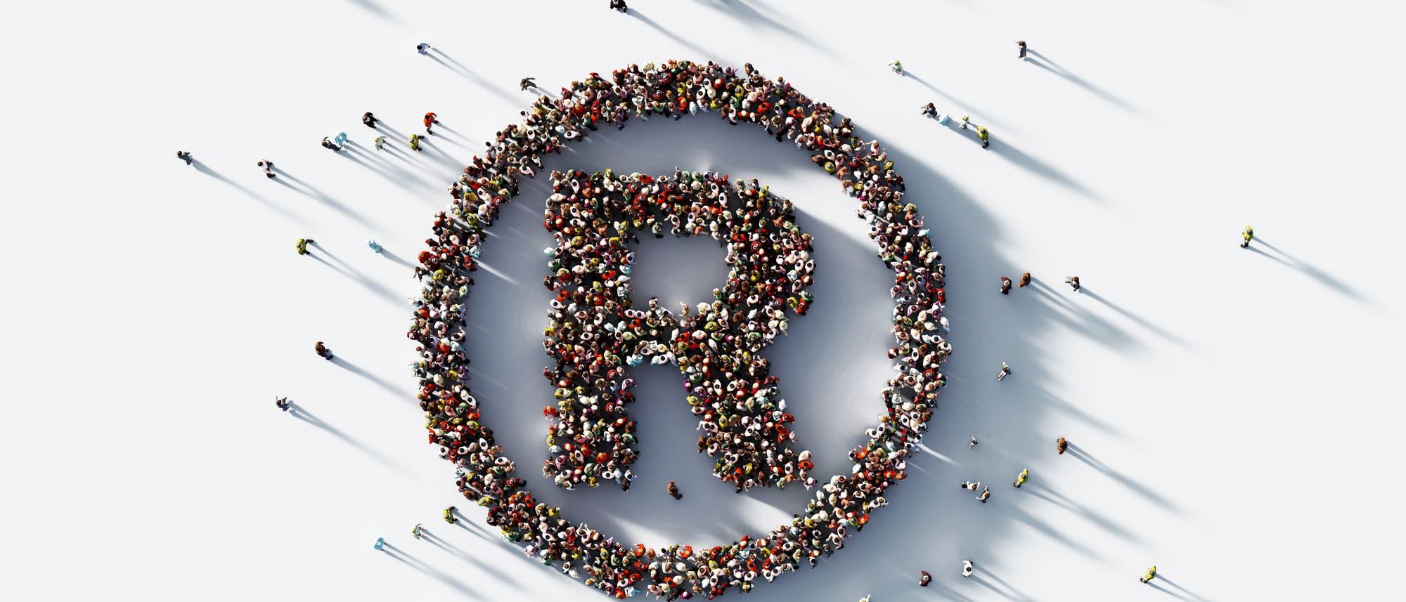 Menschen formen ein Registered-Zeichen