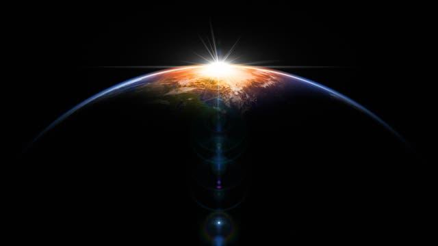 Sonnenaufgang über der Erde vom All aus