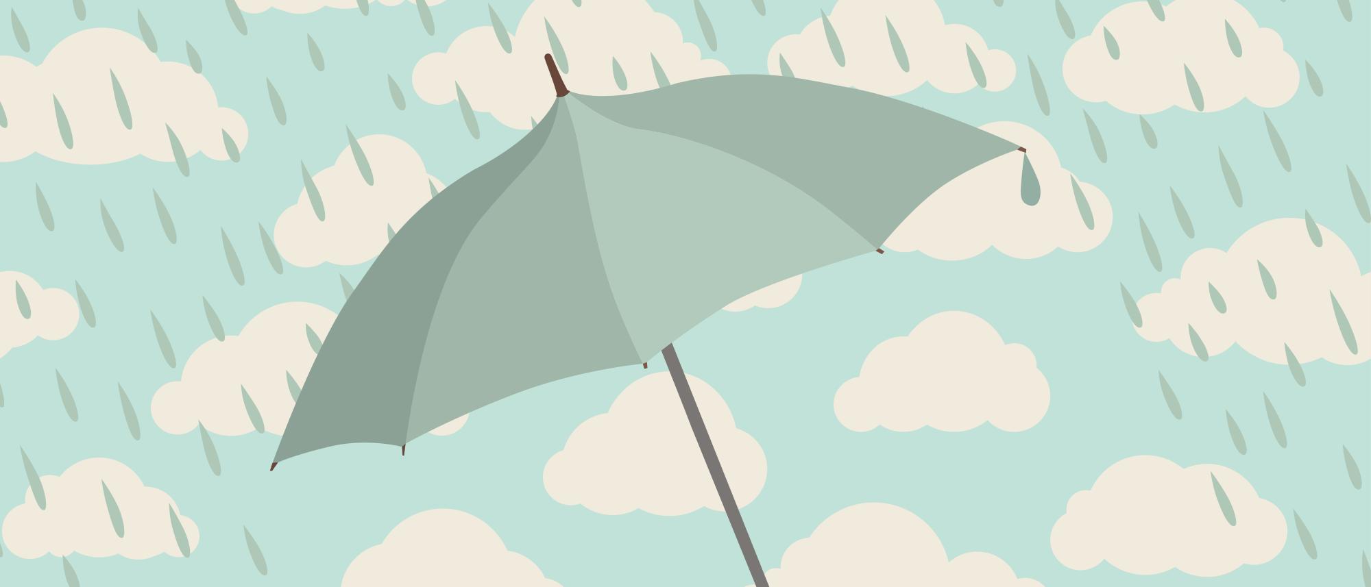 Ein Regenschirm vor verregnetem Himmel