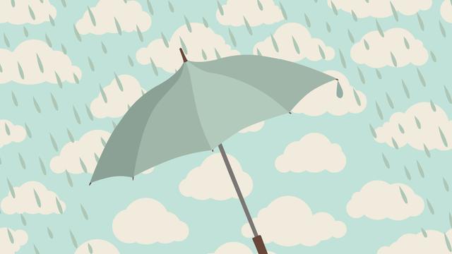 Regenschirm vor verregnetem Himmel
