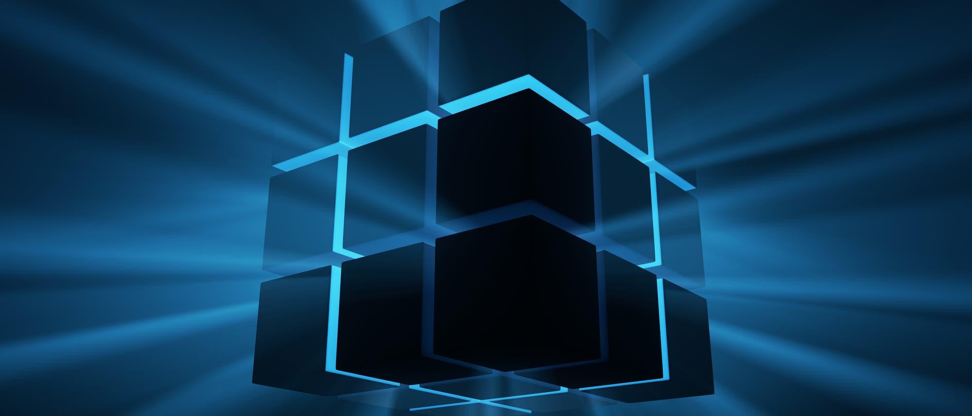 Ein sehr abstrakter Rubik-Würfel aus bläulichem Licht und schwarzen Kuben. Sieht sehr Sci-Fi-mäßig aus, aber wir wissen ja: wirklich revolutionäre Dinge haben runde Ecken.