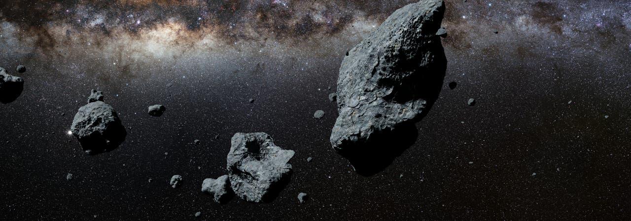 Die Illustration zeigt einen Asteroiden-Schwarm im All.