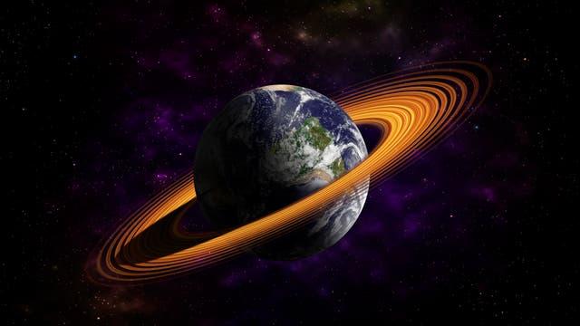 Darstellung der Erde mit einem Band aus orangefarbenen Ringen. Wir wissen nicht, aus welchem Material die Ringe sein müssten, um so eine Farbe zu haben. Aber wir zweifeln nicht, dass irgendwann jemand auf die Idee kommen wird, die Erde mit solchen Ringen auszustatten. Vermutlich im Rahmen einer Werbeaktion für Handyverträge.