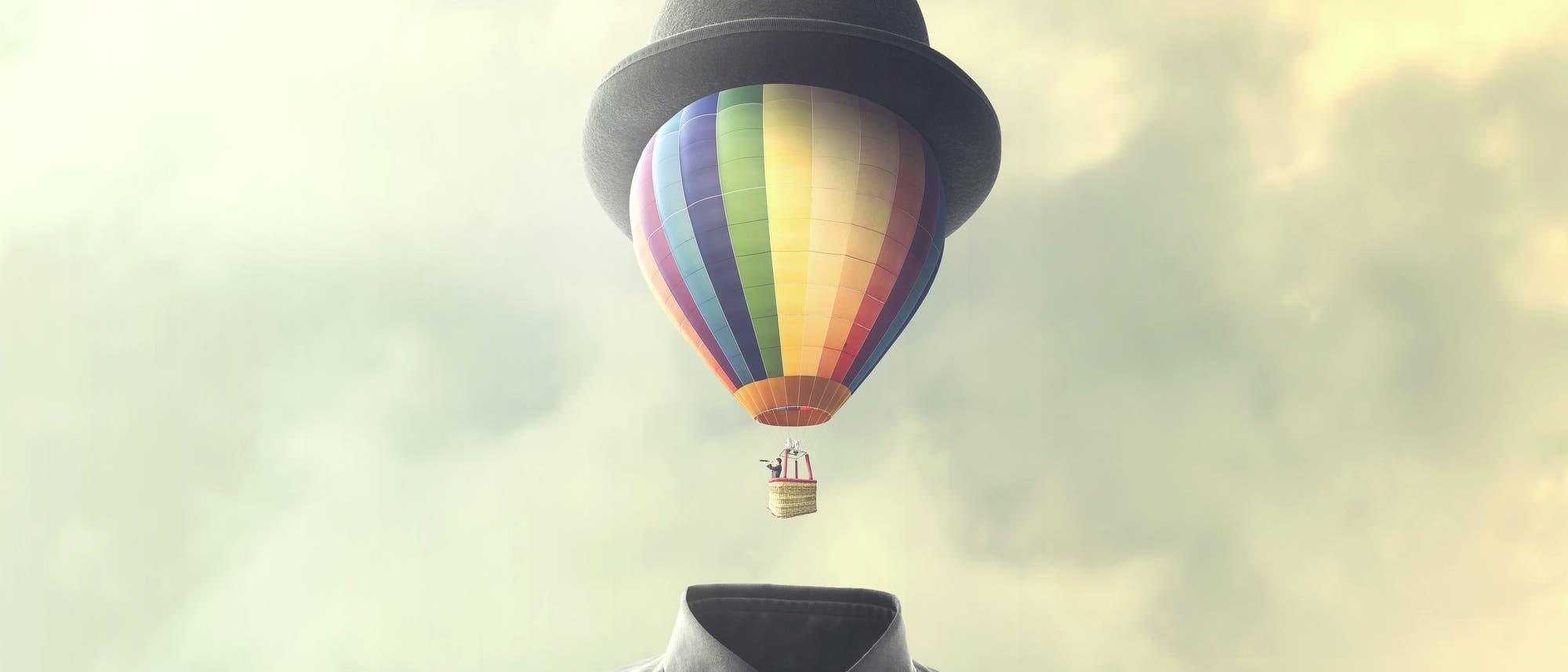 Ein heißluftballonförmiger Kopf hebt vom Körper ab, im schwebenden Korb sitzt ein Mensch und guckt durch ein Fernrohr.