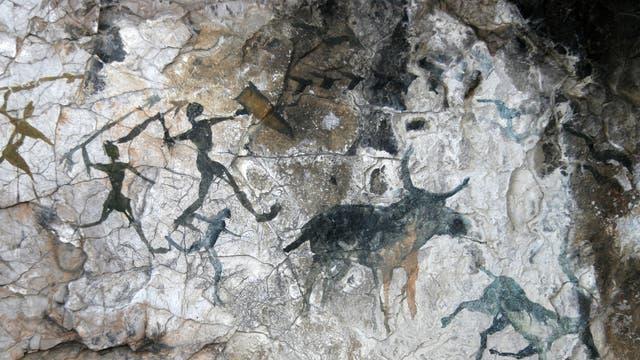 Höhlenmalerei mit Jägern und Tieren
