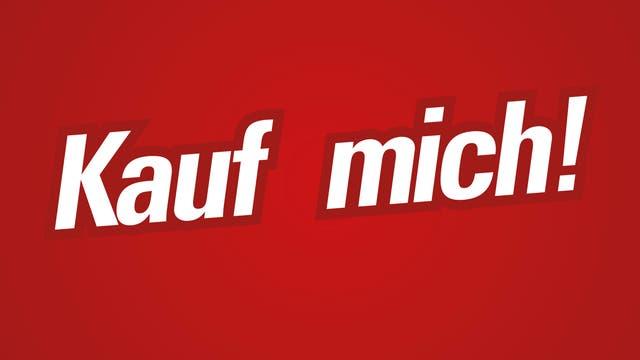 """""""Kauf mich!"""" in weißer Schrift auf rotem Grund"""